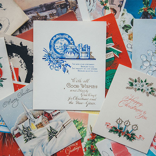 cut costs cards over presents